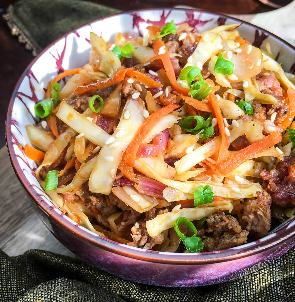 This easy Keto Egg Roll in a Bowl recipe is fast and easy with an authentic egg roll taste! Budget and family friendly low carb dinner. #lowcarb #beef #pork #easy #keto #sausage #coleslaw