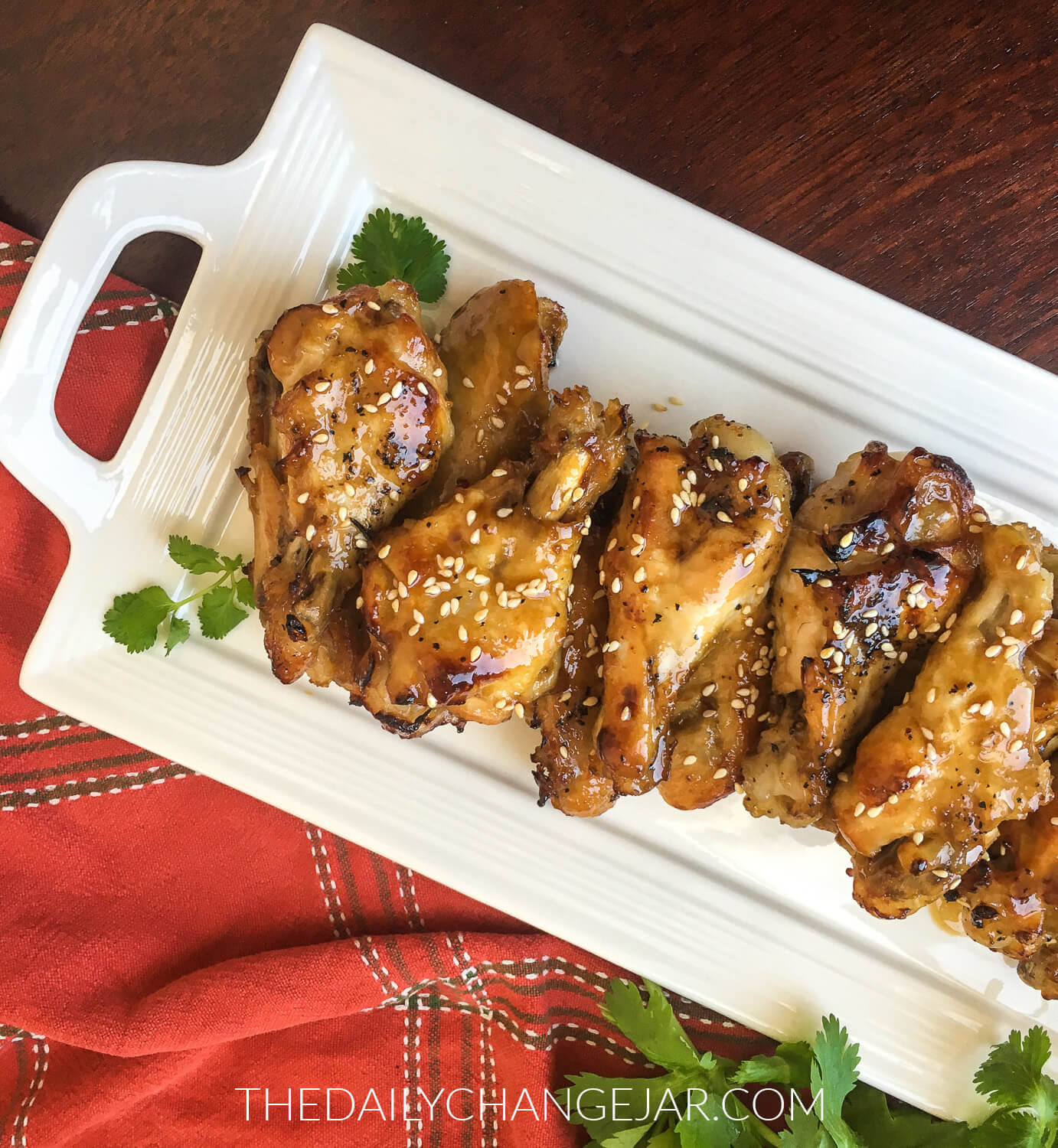 These wings have an Asian flair and are sticky, saucy, sweet, and tangy. The Instant Pot makes them so easy to whip up, SO flavorful, and are fall off the bone tender. #instantpot #chickewings #sesamegarlic #soysauce #coconutaminos