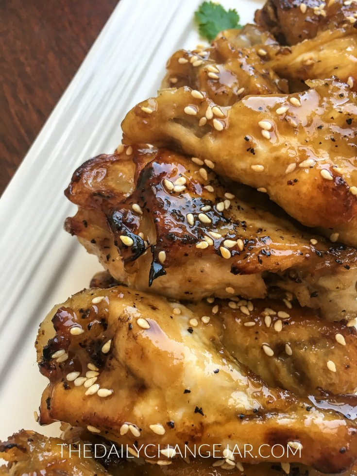 An oriental take on traditional chicken wings that is sure to please everyone. You can't beat the convenience of Instant Pot chicken wings. Give them a quick trip under the broiler for that beautiful crisp. #chickenwings #instantpot #sesamegarlic