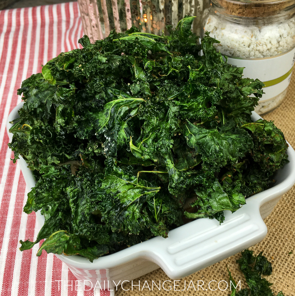 Crispy Kale Chips are not only keto, gluten-free, and vegan-friendly, they are so easy to make with fresh kale, extra virgin olive oil, and a few simple seasonings. They're packed full of nutrients, low carb, and super budget friendly. This kale chips recipe makes crispy chips that everyone will love (even the kids)! #kale #kalechips #bakedkalechips #kalechiprecipe #easykalechiprecipe #keto #glutenfree #vegan