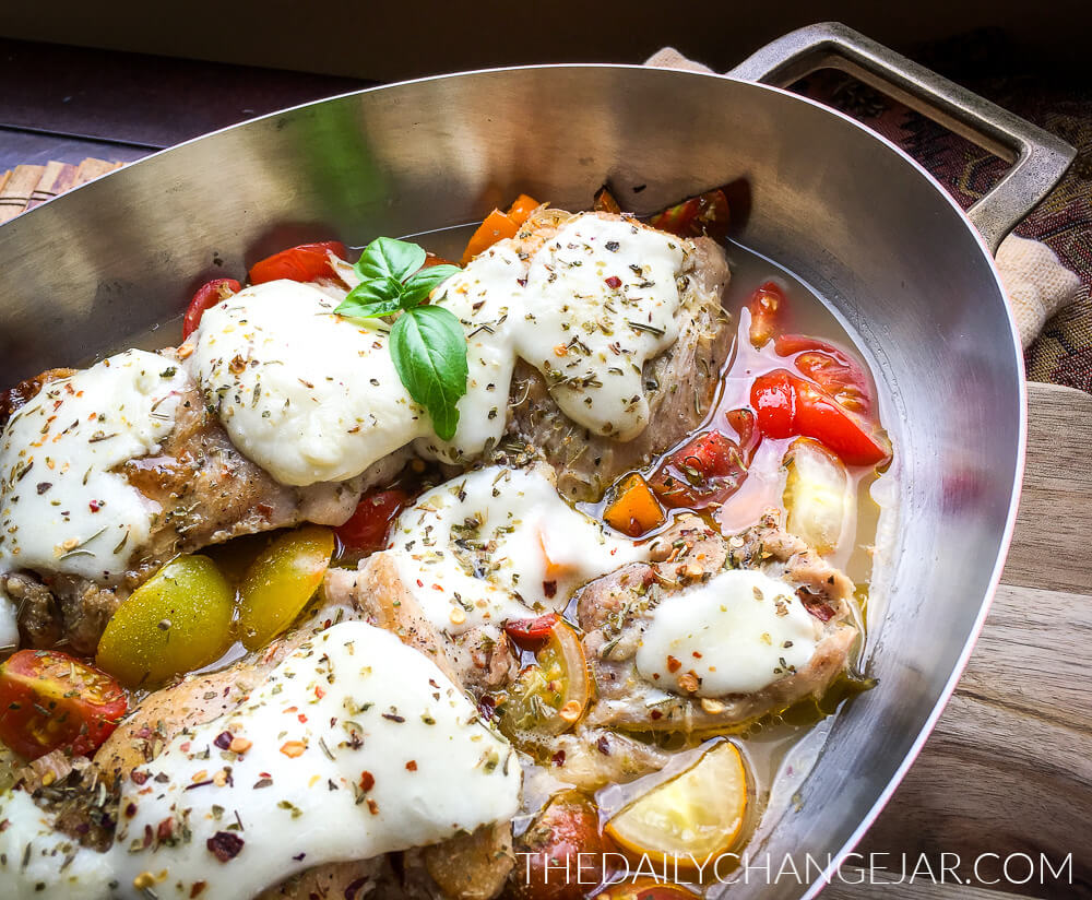 One skillet mozzarella chicken thighs are a perfect dinner to put together during a busy weeknight without having to spend too much time in the kitchen. A lovely low carb recipe that is both fresh and hearty! #chicken #chickenthighs #keto #mozzarella #oneskillet #dinner #entree