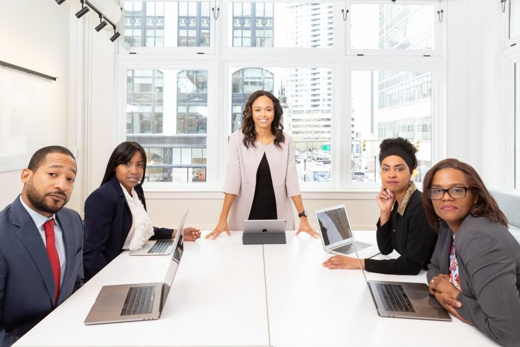 woman-standing-on-the-center-table-with-four-people-on-the-1367271